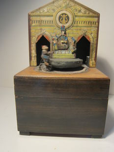 A very rare Symphonion monkey cyclist automaton disc musical box
