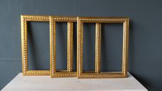 Three gilded picture frames - England - 20th century.