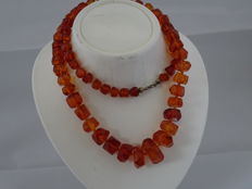 Necklace made of genuine honey-coloured faceted amber beads, 32 grams