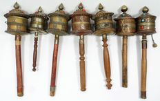 Seven prayer mills with wooden handles - Tibet - second half of 20th century