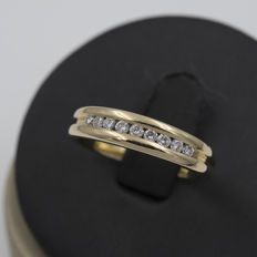 Yellow gold engagement ring set with brilliant cut diamonds.