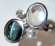 14 kt / 585 white gold, very solid and creative ring with cat's eye moonstone + 2 diamonds 0.20 ct G