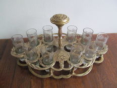 Portable brass serving rack with 10 liqueur glasses