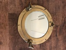 Gorgeous yellow copper porthole with mirror 20th century.