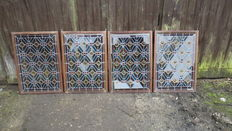 Four very old  stained glass window panels in lead.