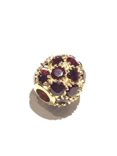 Gold pendant with rubies.