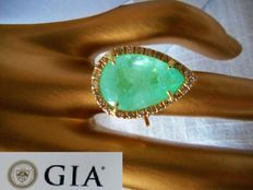 Gold ring with 10.06 ct emerald and tiny diamonds.