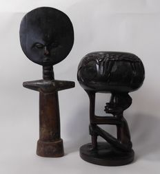 Land of ebony palm wine goblet and a wooden Akuaba