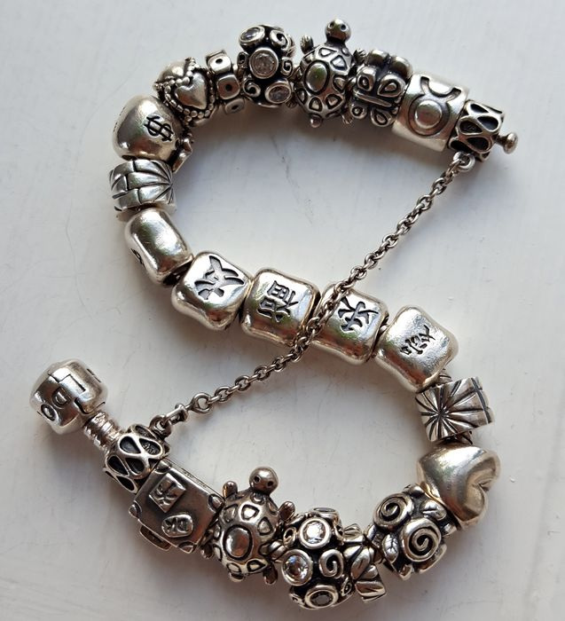 pandora bracelet with 20 pandora charms and safety chain