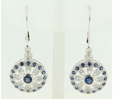 14 kt white gold dangle earrings set with sapphire and diamond, the size of the earring is 3.7 cm x 1.4 cm