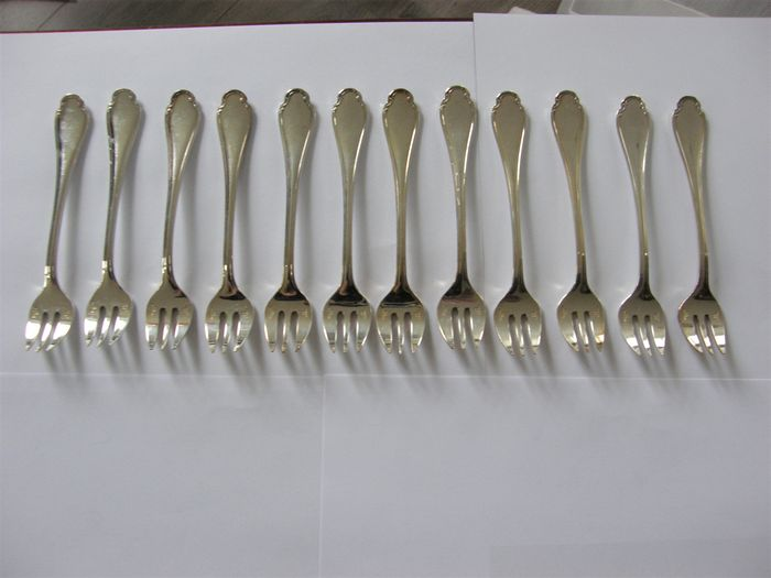 Set met 12 oestervorkjes in model Pompadour, Christofle Paris 1935-1983