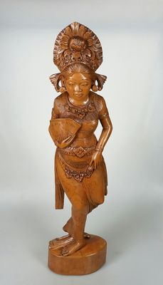 Hand-carved wooden statue of a dancer holding a fan – Bali – Indonesia
