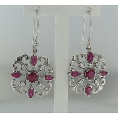 14 kt white gold dangle earrings with ruby and 8 brilliant cut diamonds, size of dangle earring 1.7 x 1.7 cm.