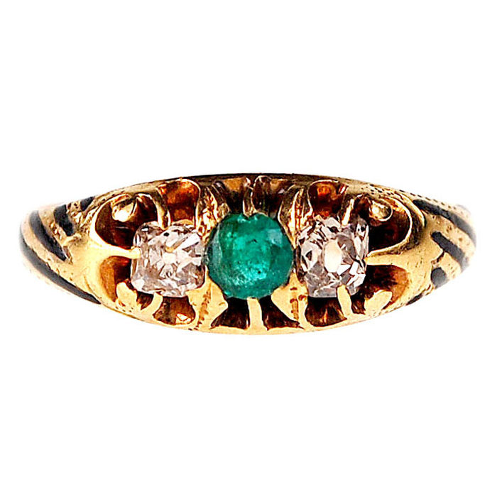 A ring features 0.25ct Cushion Cut Diamonds, 0.20ct Emerald decorated with Enamel in 14k Gold.