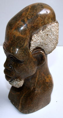 African carved granite head