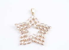 Star-shaped yellow gold pendant with zirconias