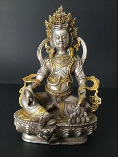 Silver-plated and gilt copper depiction of Jambhala – Nepal – Late 20th century