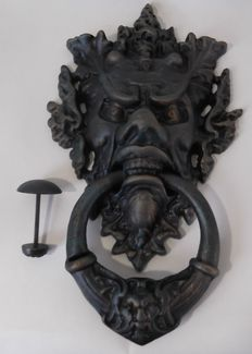Large door knocker in the shape of a satyr.