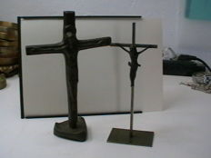 Two antique crucifixes, in classic bronze