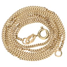 Yellow gold curb link bracelet.