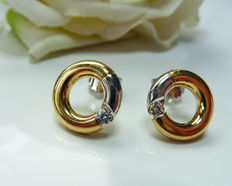 14 kt gold earrings with Top Wesselton diamond
