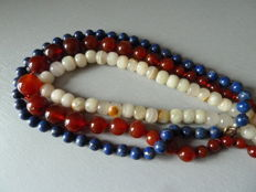 Three necklaces made of African stones, lapis lazuli, agate, carnelian beads