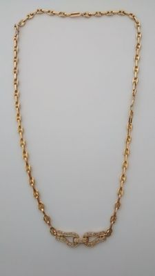 Necklace in 18 kt gold with diamonds