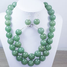 Green jade set with silver brooch.