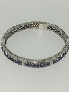 White gold bracelet with 16 diamonds and 176 sapphires