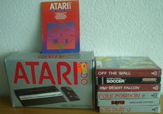 Atari 2600 console with controller and 7 games