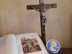A silver plated crucifix and Family bible