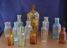 Collection of 12 glass pharmacy bottles, European, 19th century