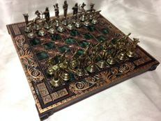Embossed copper chess set with bronze pieces and fine metals of chess in Greek style.