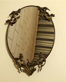 Beautiful oval mirror with copper-coloured wood carvings - first half 20th century