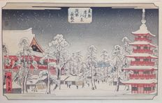 Coloured woodcut of the snow-covered Kinryuzan buddhist temple in Asakusa by Ando Hiroshige (1797-1858) (reprint) - Japan - ca. 1930.