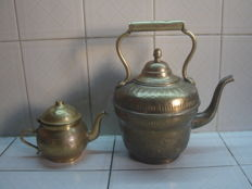 Brass ewer and teapot with meticulous embossed decoration. Fez, Morocco, early twentieth century.