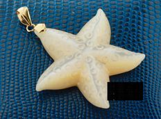 Mother of pearl starfish pendant inlaid with gold