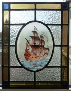Beautiful stained glass window with a picture of Dutch East India Company ship, restored