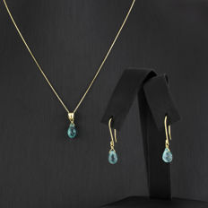 Set of yellow gold necklace and earrings with blue topazes