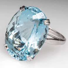 Large white gold ring with oval aquamarine, 10.23 ct.