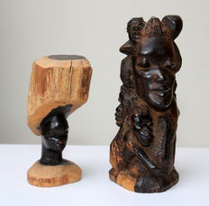A beautiful mother sculpture and female head, both crafted from 1 piece of wood.