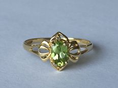 Gold decorative ring with peridot.