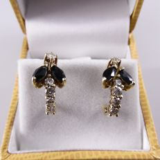 Gold ear studs with blue sapphires and brilliant cut diamonds