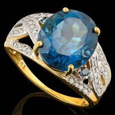 Estate 14k gold ring set with London blue topaz 6.82ct in total, and 36 diamonds **No reserve price**