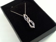 Silver pendant with diamond on a silver necklace.