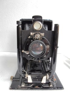 A Steinheil bellows camera with a number of glass plate holders and two developing bins.