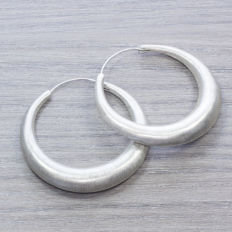 Large Italian morcilla hoop earrings in sterling silver.