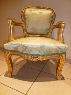 A few gold-painted ladies armchairs in Louis XV style, 20th century