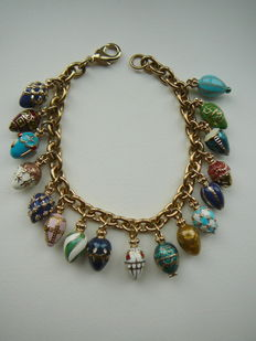 Hand-crafted bracelet with 17 enamel eggs – Fabergé style – The Bradford Exchange.