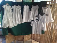 Seven children's dresses and laces - first half of xx century- England- Batista and hand embroidered lace